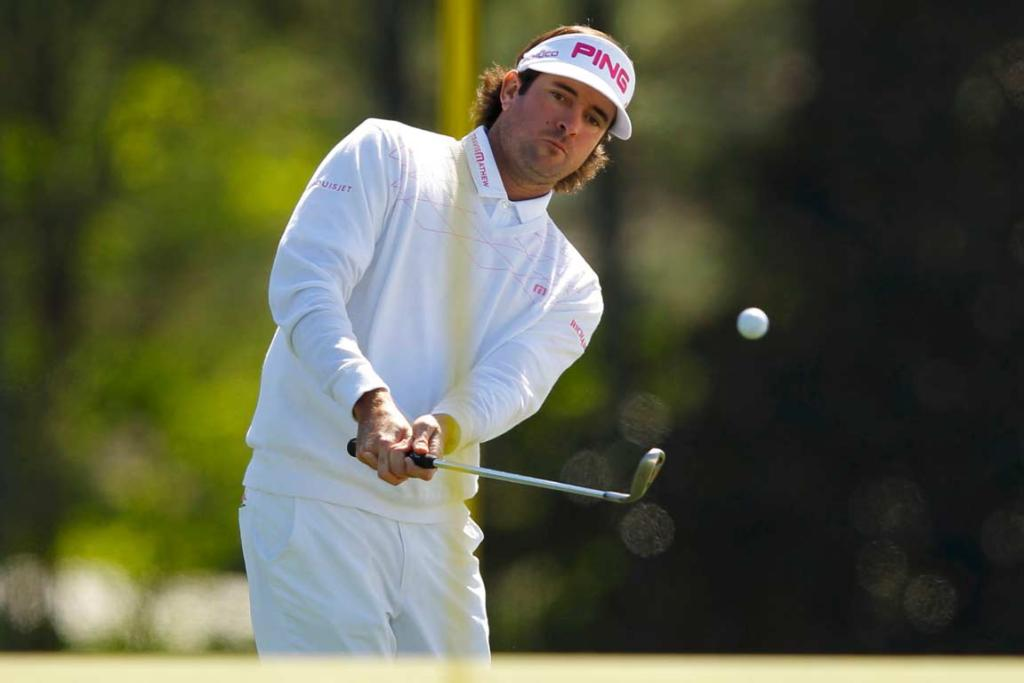 Bubba Watson plays a chip-shot from the front of the 18th green.