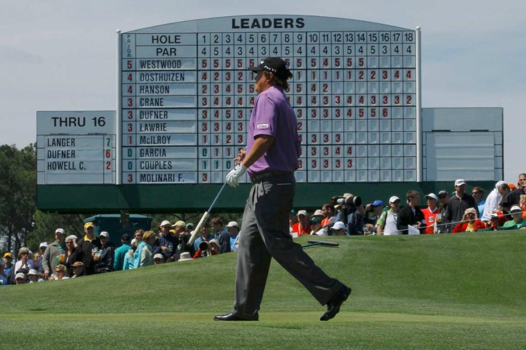 Second round co-leader Jason Dufner in front of the leaderboard at the 18th hole.