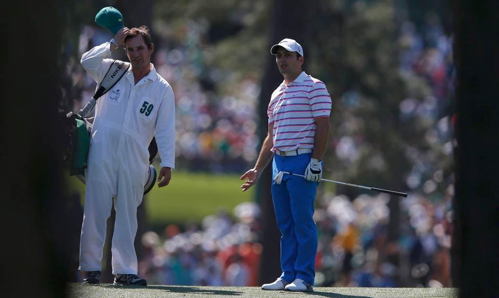 Italy's Francesco Molinari ponders what went wrong on his approach shot to the 17th green.