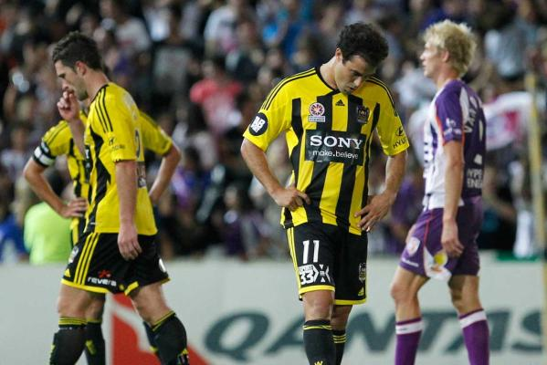 Dejected Phoenix players Tim Brown and Daniel