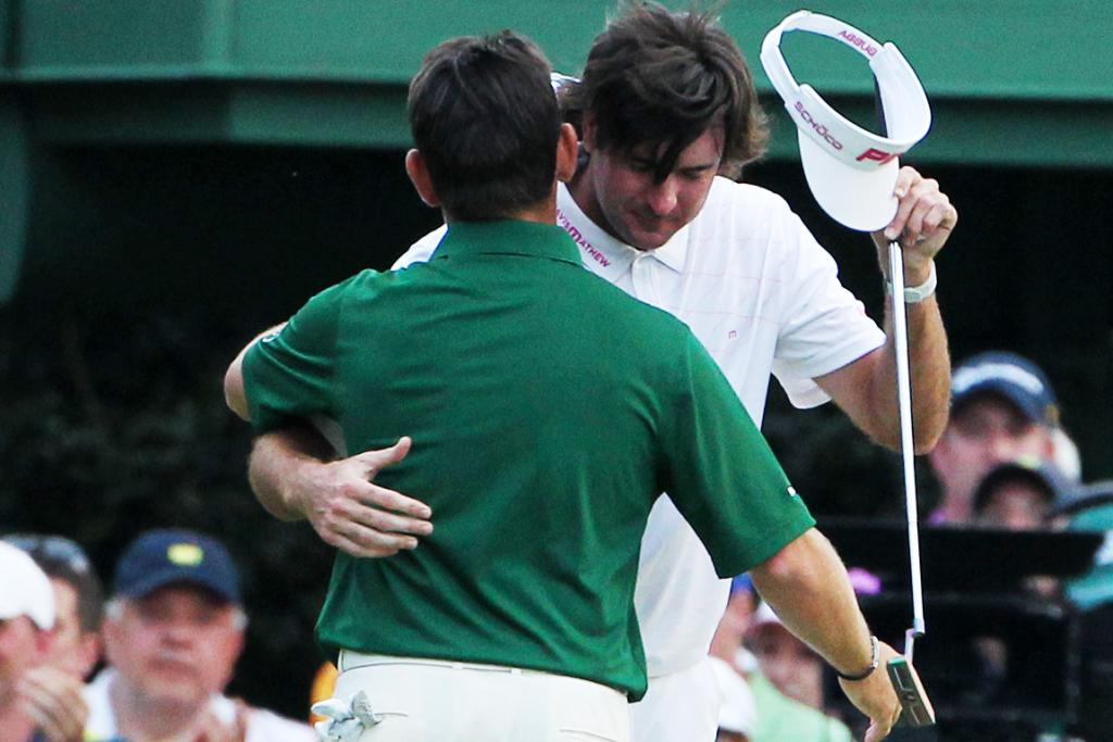 Bubba Watson of the United States hugs Louis Oosthuizen of South Africa after Watson won their sudden-death playoff on the second playoff hole to win the 2012 Masters Tournament at Augusta.