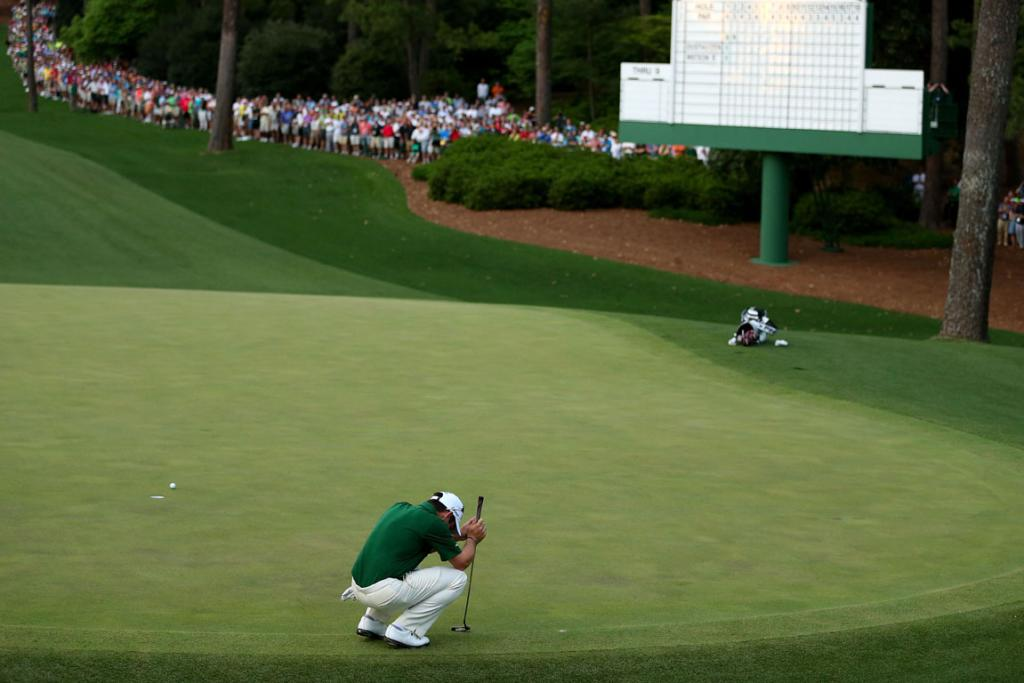 Louis Oosthuizen of South Africa reacts after missig a putt on the second sudden death playoff hole on the 10th during the final round of the 2012 Masters Tournament.