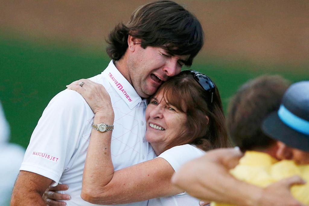 Bubba Watson of the US celebrates winning the Masters with his mother Mollie during a playoff in the 2012 Masters Golf Tournament.