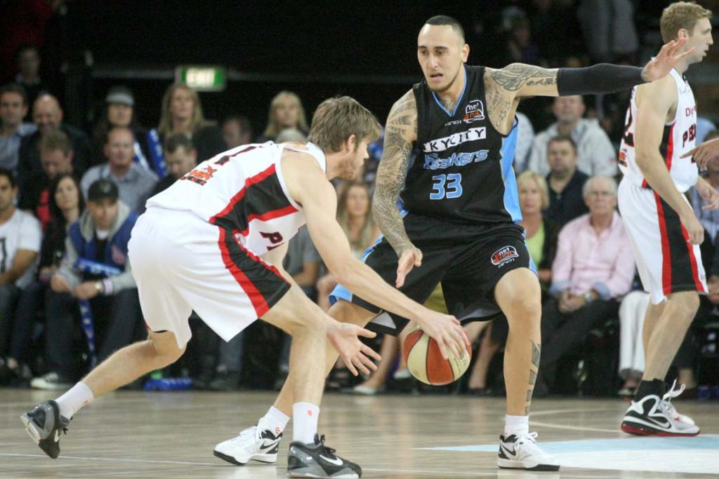 Small forward Leon Henry defends Perth's Cameron Tovey.