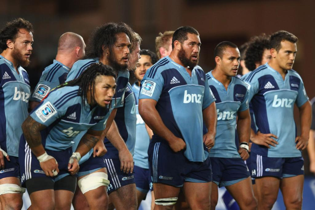 The Blues are disconsolate after conceding a try to the Sharks.