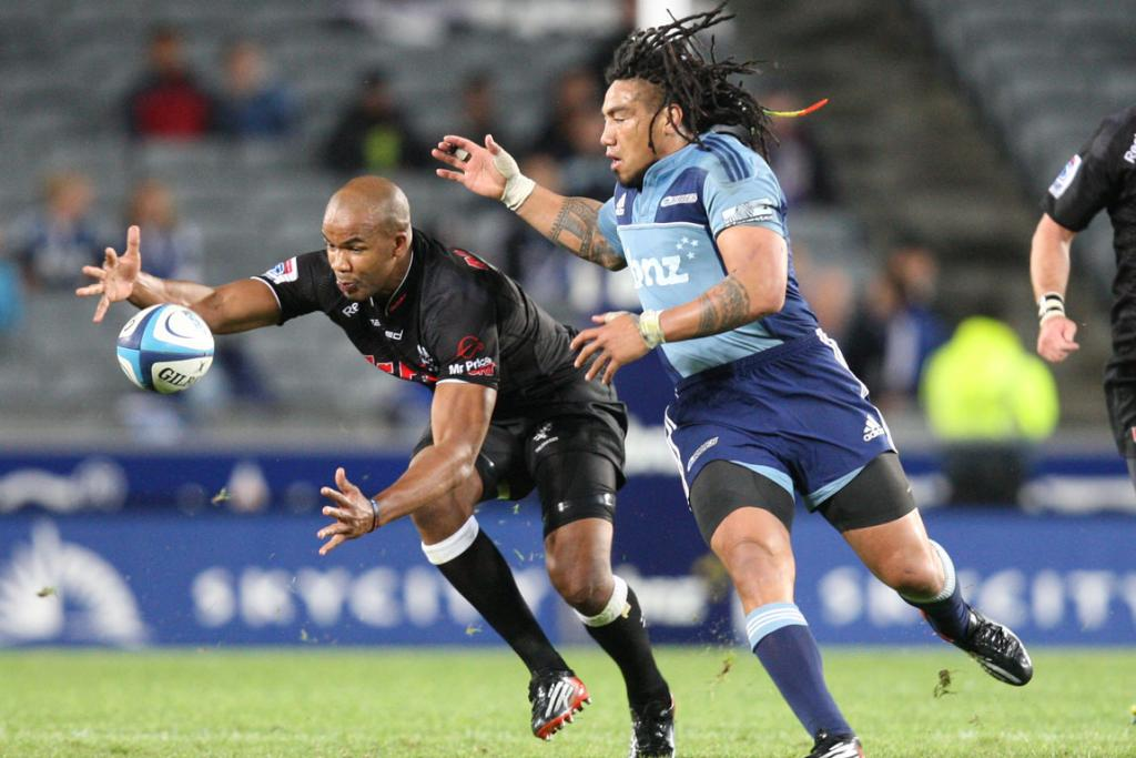 Ma'a Nonu chases JP Pietersen and the ball during the Blues' loss to the Sharks.