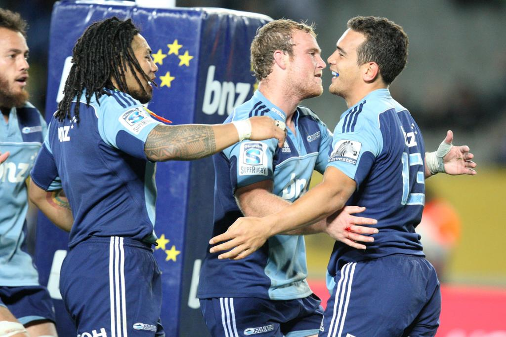 Blues players celebrate Benson Stanley's try against the Sharks.