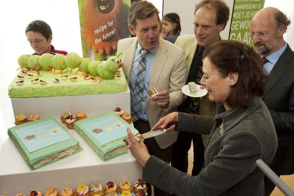 Professor Louise Fresco (second from right) and authors of The Insect Cookbook, Henk van Gurp (centre), Marcel Dicke (third from right) and Arnold van Huis (right), eat a piece of cake made of insects at the University of Wageningen.