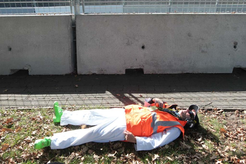A V8s safety crew member takes a rest during a break in practice sessions.