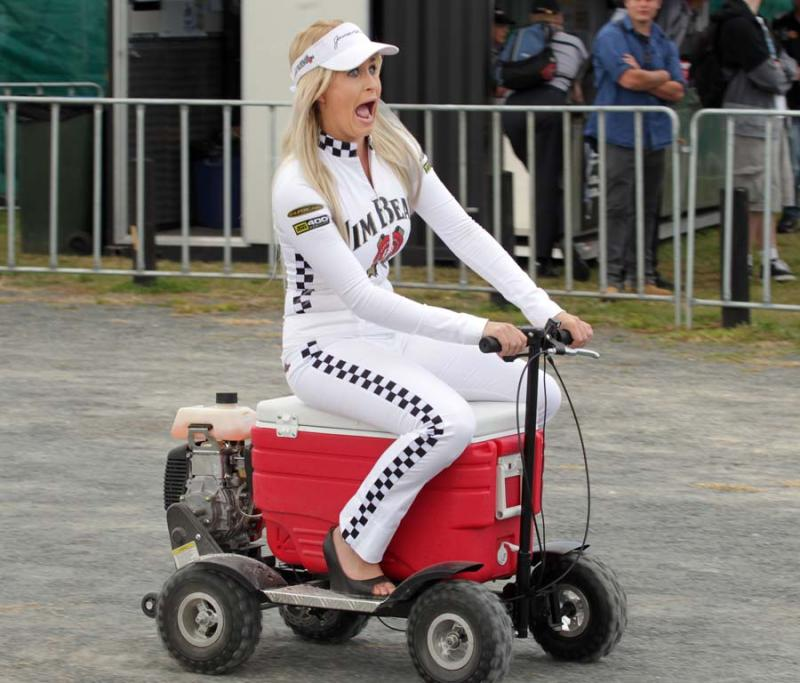 Jim Beam promo girl Ashleigh Wright takes a ride on a motorised chilly bin.
