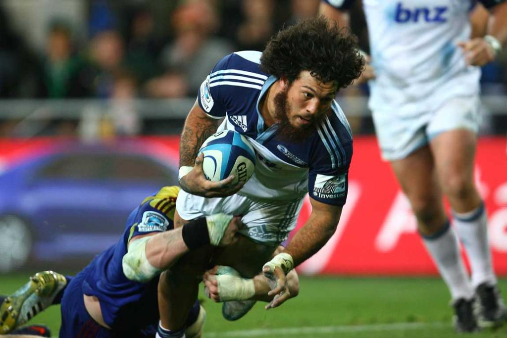 Rene Ranger of the Blues dives for the tryline against the Highlanders.