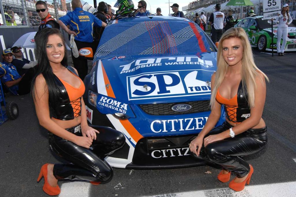 SP Tools grid girls in front of Shane van Gisbergen's Ford.