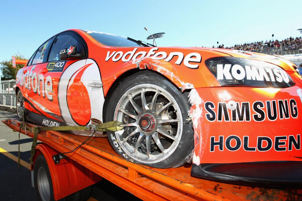 Team Vodafone Holden of Jamie Whincup is returned to the pits after he hit the wall during qualifying.