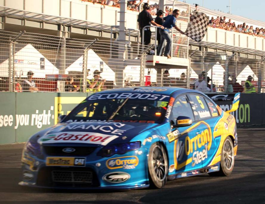 Ford's Mark Winterbottom takes the chequered flag in the final V8 Supercars race in Hamilton.