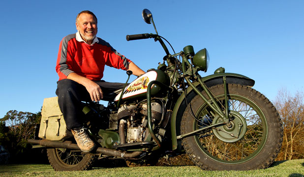 RIGHT HAND FREE FOR SHOOTING: Dennis Young aboard  his 1941 Indian motorcycle, which will be on display next weekend.