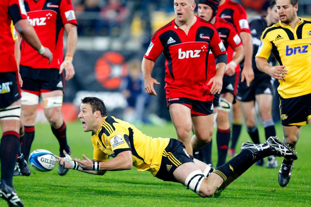 Hurricanes' Jeremy Thrush passes against the Crusaders.
