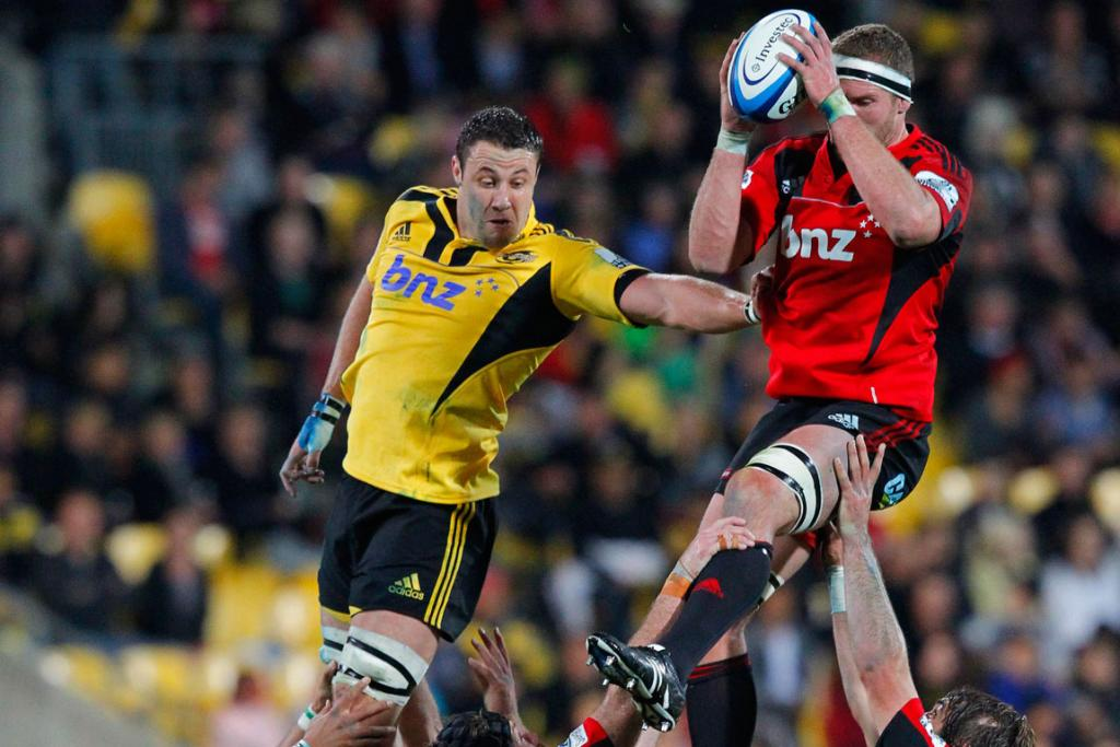 Hurricanes' Jeremy Thrush and Crusaders' Kieran Read battle for the ball.