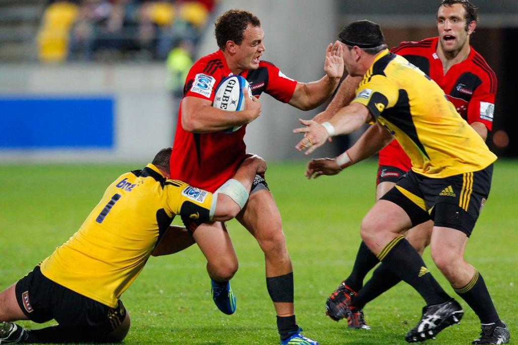Crusaders' Israel Dagg is tackled by Hurricanes' Ben May.