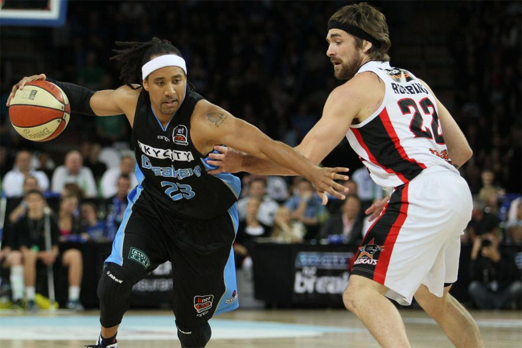 Breakers' guard CJ Bruton goes past Perth Wildcats' point guard Brad Robbins.