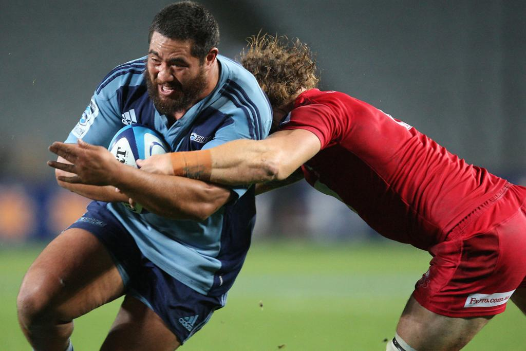 Blues tighthead prop Charlie Faumuina tackled by Reds' Scott Higginbotham.