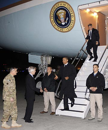 US President Barack Obama is greeted by Lieutenant General Curtis