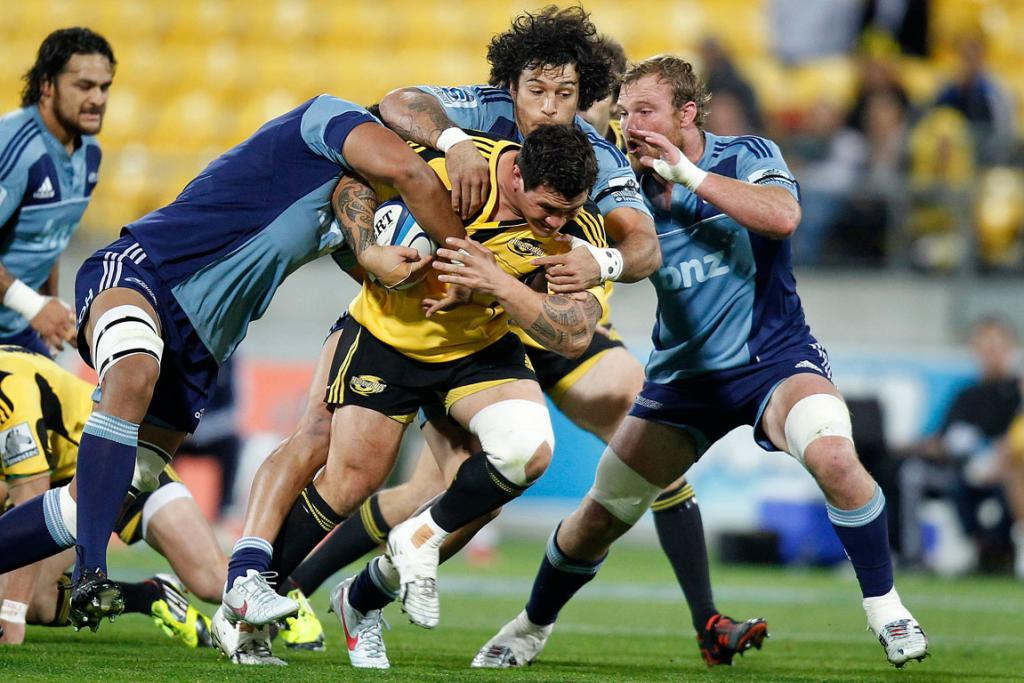Hurricanes' Karl Lowe on the charge against the Blues.