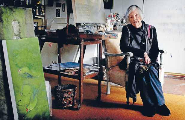 AN ARTIST AT HEART: Hamilton based artist Joan Fear sits, surrounded by her canvases, as she ponders a life devoted to painting and helping the art community in the Waikato.