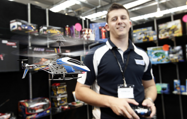 LIFT-OFF: Jarrad Douglas, of Electus Distribution, flies an i-hel at the New Zealand Toy Distributors Association toy fair at Claudelands Events Centre in Hamilton at the weekend.