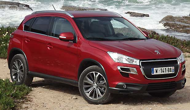 "PEUGEOT 4008: The French concern's ""baby SUV"" uses the company's new floating grille frontal treatment very effectively."
