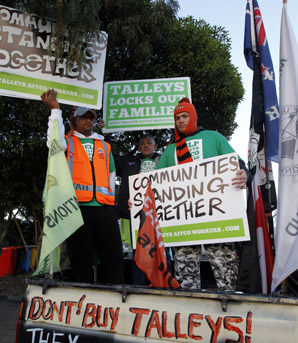 TAKING IT TO THE TALLEYS : Affco workers Souljah Wroe, left, Adrian Harwood and Nathan Easton leave the Tahuna Beach Holiday Park to protest outside Talley Family homes in Motueka.