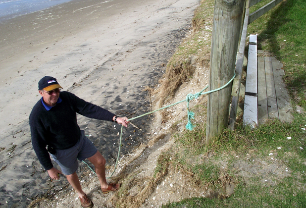 NO ACCESS: Commodore Al Gould demonstrates how some enterprising locals have improvised a rope access to Buffalo Beach.