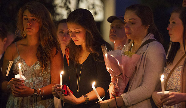 MOURNING: Boston University students at a candle light vigil on their campus after the deaths of three students in a car crash near Tongariro.