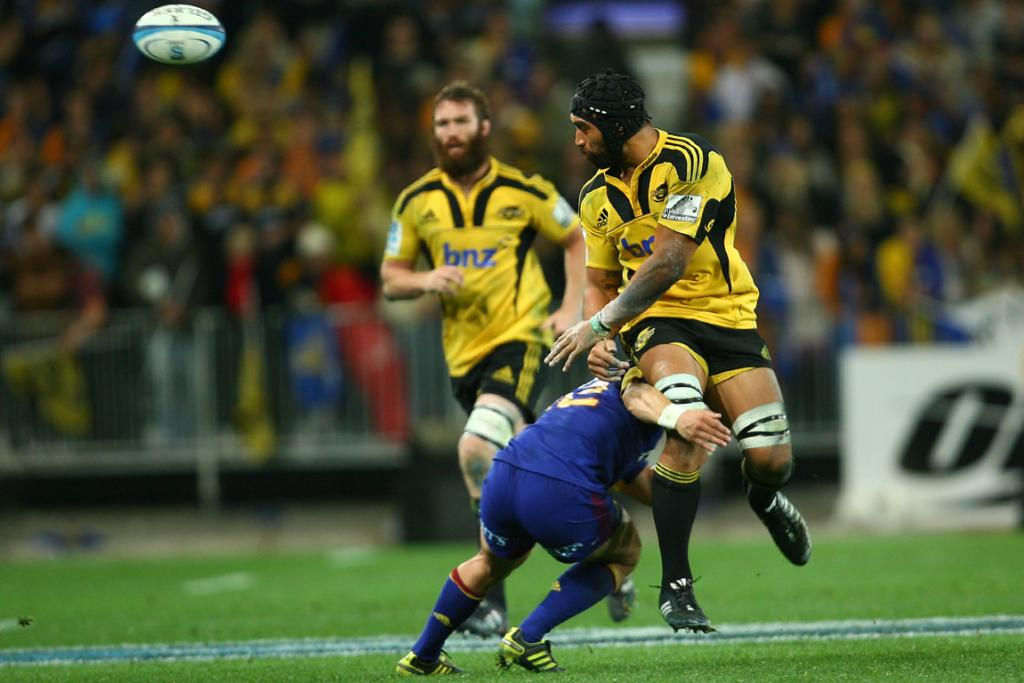 Victor Vito of the Hurricanes passes against the Highlanders at Forsyth Barr Stadium.