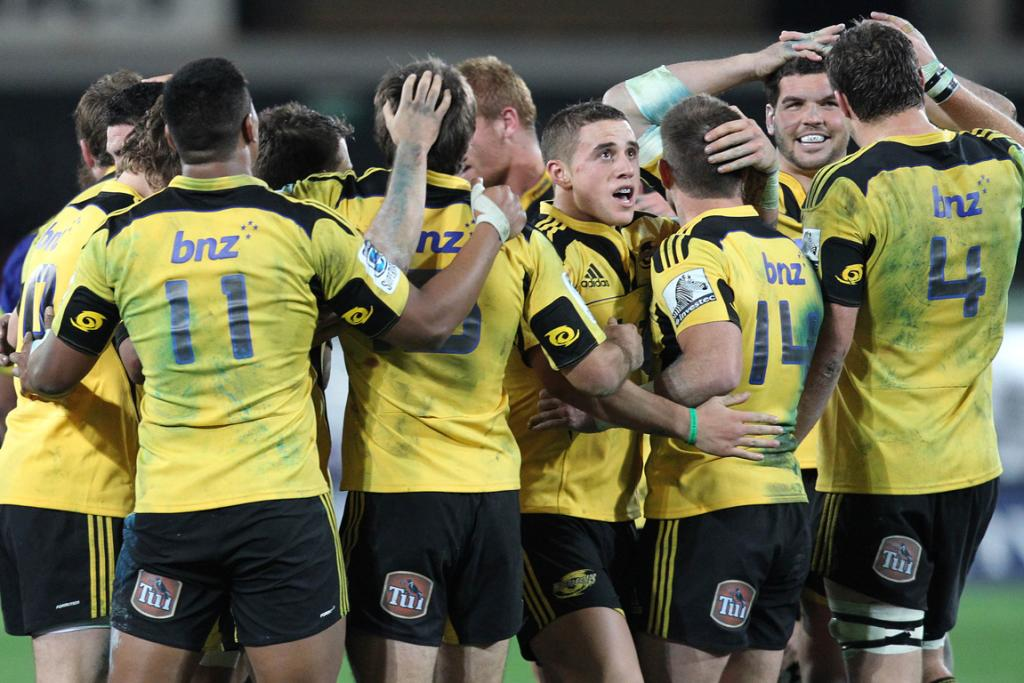 Hurricanes players celebrate their 26-20 win over the Highlanders.