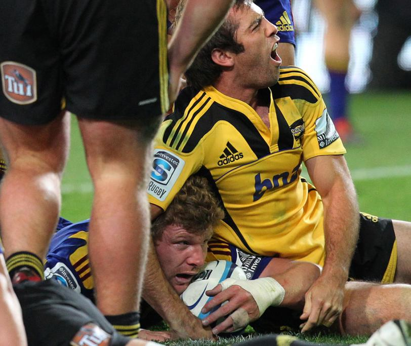 Conrad Smith of the Hurricanes is not happy at Adam Thomson of the Highlanders being allowed his try.