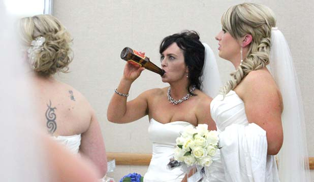 SOMETHING (C)OLD: Hawera farm worker and March bride Katrina Hayman cools off with a swig of beer at the Taranaki Bride of the Year competition.