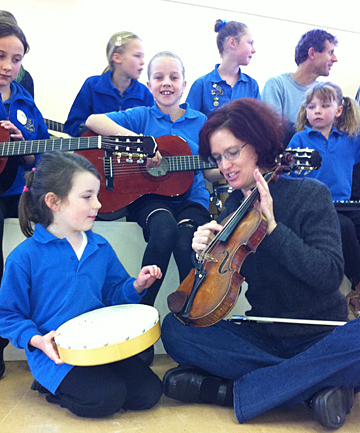 Gore Main School pupil Alisha Barr, 6, and Christchurch Symphony Orchestra violinist and outreach co-ordinator Cathy Irons during this morning's session at the school.