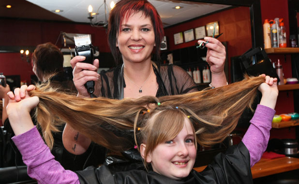 Farrin Brown, 12, just seconds before her long locks are cut off by Kirsten Timothy