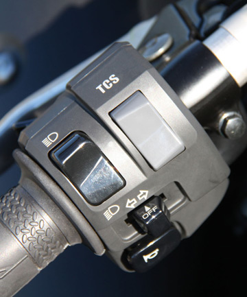 The TCS (Traction Control System) switch that lets you select one of six levels of electronic intervention on the Yamaha R1.