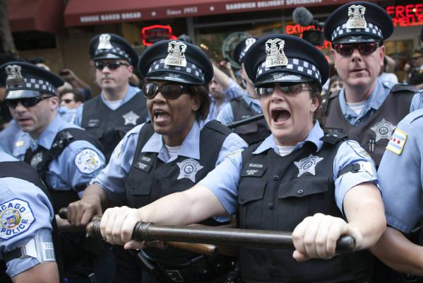 Police charge at protesters during an anti-Nato protest march in Chicago.