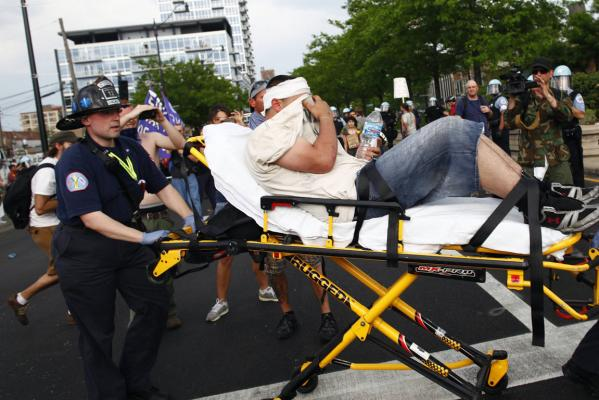A demonstrator is taken away on a stretcher during an anti-Nato protest march in Chicago.