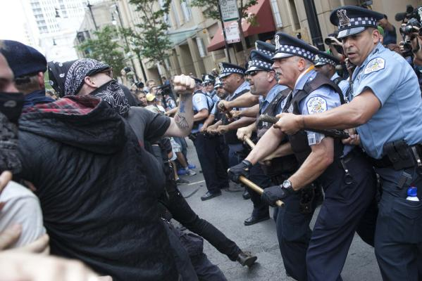 Police clash with protesters during an anti-Nato protest march in Chicago.