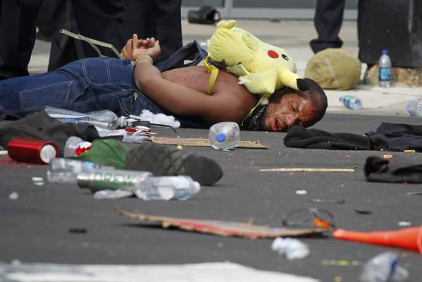 A protester lies detained after clashing with police during the start of the Nato Summit in Chicago.