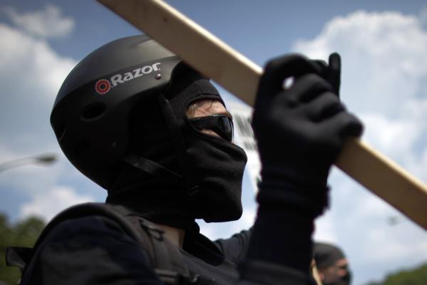 A demonstrator wears protective gear during an anti-Nato protest march in Chicago.