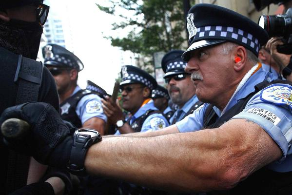 Demonstrators clash with the police during an anti-Nato protest march in Chicago.