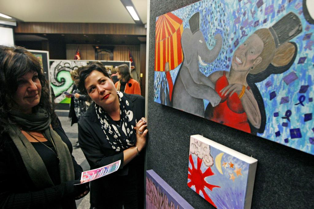 COLOURFUL DANCE: Andrea Armstrong and Sarah-Jane Garden looking at 'Big Beautiful Creatures' by Amy Faifai at the Youth Alley art exhibition in the Council Chambers.