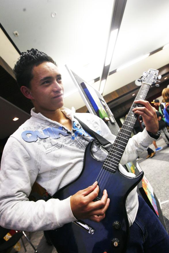 ARTISTIC GUITARIST: Hamiana Henry provided music for the evening as well as contributing artworks at the Youth Alley art exhibition in the Council Chambers.