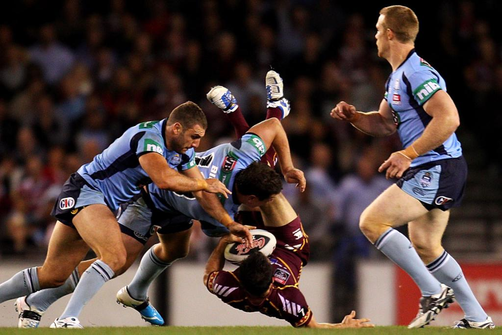 Cooper Cronk of the Maroons is dumped in a tackle during game one at Etihad Stadium.