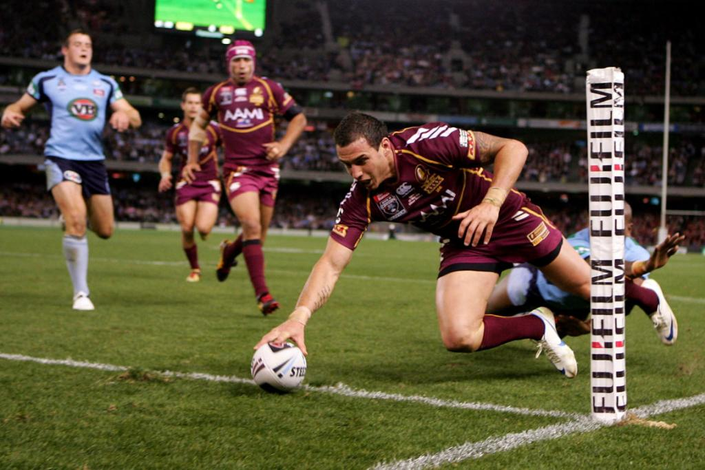 Darius Boyd of the Maroons scores a try during game one at Etihad Stadium.