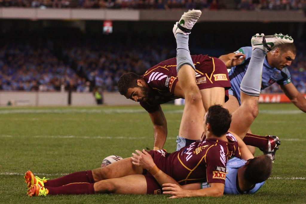 Greg Inglis of the Maroons scores a try during game one at Etihad Stadium.